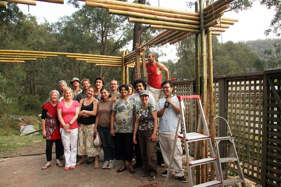 Satisfied and happy workshop participants who helped make the structure.